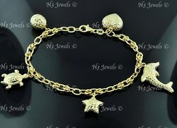 18k Yellow gold hollow Dolphin Turtle star Assorted charm bracelet #8391 6.30gr $545.00