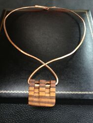 pARTicular authenticated limited edition pendant  serial no 008