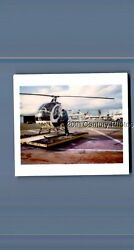 FOUND COLOR POLAROID K1802 MAN POSED BY SMALL HELICOPTER $3.98