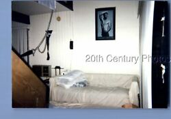 FOUND COLOR PHOTO O7483 PICTURE OF BEEFCAKE HANGING ON WALL ABOVE COUCH $6.98