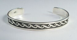 925 sterling silver cuff bracelet with wave designh and matte finish 38