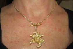 $12000.00  CATHY CARMENDY 20K Wildflower Pendant with Yellow and White Diamonds