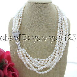 S111104 21'' 9Strands White Rice Pearl Torsade Necklace