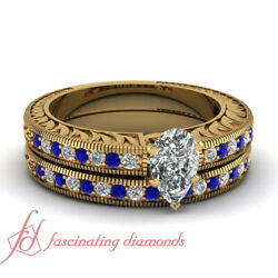 1 Carat Yellow Gold Pear Shaped Diamond And Sapphire Engraved Wedding Rings Set