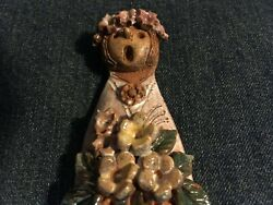 Signed pottery colorful wall hanging lady singing or yelling amp; flower bouquet $40.00