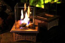 Tabletop Glass Fireplace This indooroutdoor lantern can warm your heart!