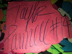 red autographed paper w number 14 to symbolize the number of shows she's been in