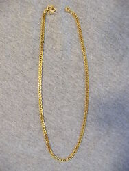 24K YELLOW GOLD FLAT OVAL and YELLOW GOLD BRAIDED HERRINGBONE - TOTAL 62.2 grams