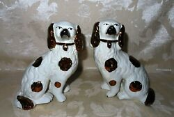 Antique Pair of Matching Staffordshire Spaniel Dogs in Copper Luster