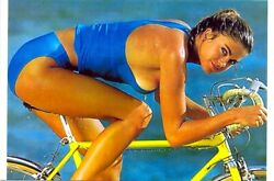 KATHY IRELAND IN A BLUE BIKINI ON A BIKE SEXY $1.50