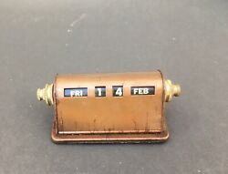 vintage copper-colored metal perpetual desk calendar 1940s