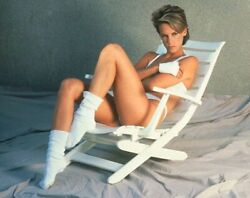 JAMIE LEE CURTIS SITTING AND RELAXING WITH A BIKINI ON SEXY PIC $1.50