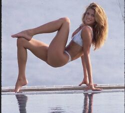 STEPHANIE SEYMOUR BEING FLEXIBLE WITH A BIKINI ON $1.50