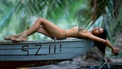 BARBARA CARRERA IN A BIKINI ON HER BACK ON TOP OF A BOAT $1.50