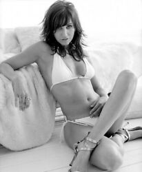 GINA GERSHON SITTING IN HER LIVING ROOM WITH A BIKINI ON #2 $1.50