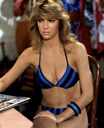 HEATHER LOCKLEAR SITTING WITH A BIKINI ON $1.50