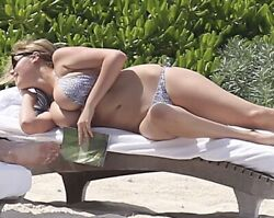 KATE UPTON LYING DOWN IN A BIKINI AND ALMOST FALLING OUT OF IT $1.50