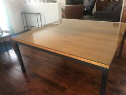 Modern Room amp; Board parsons dining table w natural steel base and walnut top. $810.00