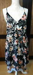 Strappy short summer dress with peach flowers on black. By Rip Curl. Size: XL $36.40