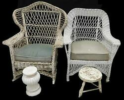 Pair of wicker arm chairs: first rocking chair with open woven wing ... Lot 311