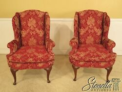 28831E28832E: Pair Red Damask Upholstered Wing Back Easy Chairs