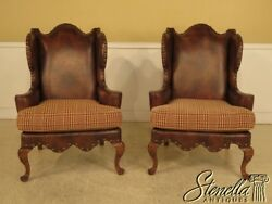 L28971E: Pair CENTURY Upholstered Wing Back Leather Chairs