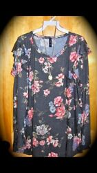 womens floral boutique style top long sleeve with with ruffle detail and pocket $18.00