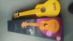 Ukulele set-Made by Sheffield. Never used.Includes pick instruction book and CD