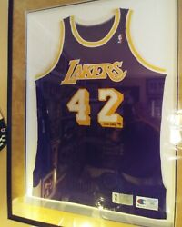 James Worthy Game Used Autographed Laker Jersey beautifully framed