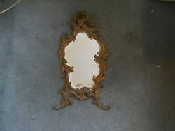 hanging antique beveled mirror in a very decorative frame $400.00