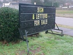 Double sided portable outdoor sign with letters