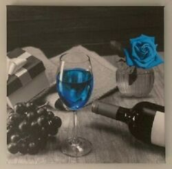 Canvas Wall Art with Blue Liquid and Flower $11.99