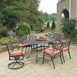 Biscayne Rust Bronze Oval 7 Pc Outdoor Dining Table with 4 Arm Chairs