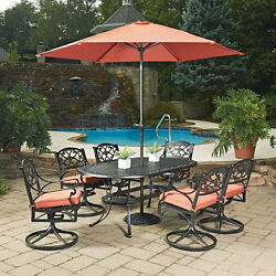 Biscayne Black Oval 9 Pc Outdoor Dining Table 6 Swivel Rocking Chairs with Cush
