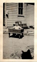 1920s Baby Boy Squinting Outside in Wooden Bouncer Chair FOUND BW Photo 00216 $6.98