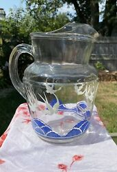 Vintage glass pitcher with ocean scene $20.00