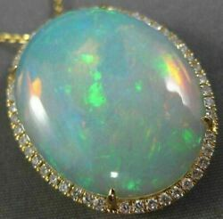 ESTATE EXTRA LARGE 14.04CT DIAMOND & AAA OPAL 14KT YELLOW GOLD OVAL HALO PENDANT