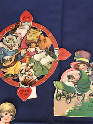 6 VINTAGE MOVEABLE VALENTINES WITH PUPPIES $28.00