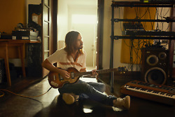 Tame Impala Kevin Parker Sitting on floor with guitar Poster 24x36 Inches $20.00