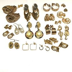 Lot of vintage modern gold toned earrings. 19 pairs. Costume jewelry. $19.99