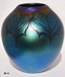 Iridescent Blue Vase with Red Feather Design.  By Saul Alcaraz. Blown Glass
