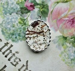 Vintage Recycled Broken Gold Swirl China Snowman in a Snowstorm Oval Pendant $22.50