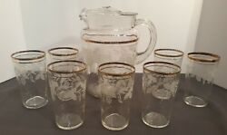 Vintage Glass Pitcher with 7 Glasses Grapevine Etching with Gold Trim $18.00