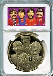 Beatles Gold Coin in a Yellow Submarine Figure Coin Bank Graphics Display