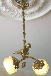 bronze angel chandelier and porcelain flowers angel carrying 2 roses. $625.00