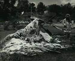 1984 Press Photo A firefighter examined the wreckage of a helicopter crash $19.99
