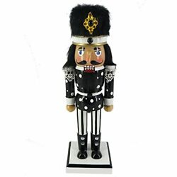 Wooden Nutcracker Black and White Jacket and Fur Hat with Stripes 10 Inch