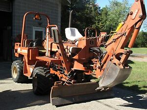 Ditch Witch 5010 With Backhoe And Plow Attachments