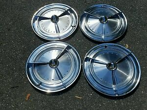 1960 Pontiac Accessory Spinner Hubcaps W Bullet Center In The Gm Box Lead Sled