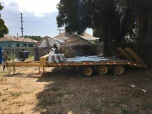 3 axle Flatbed Trailer With Added Bonuses Storage And A Gas Pump